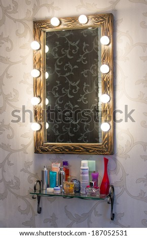 Woman's makeup place with mirror - stock photo