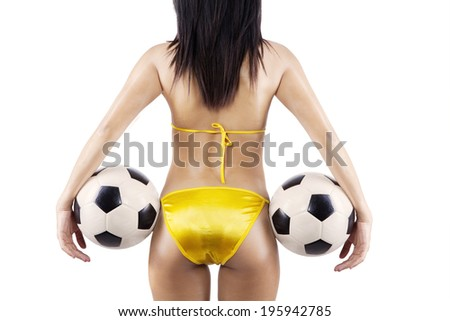 Woman's Sexy Backside Holding a Soccer Ball. isolated on white background - stock photo
