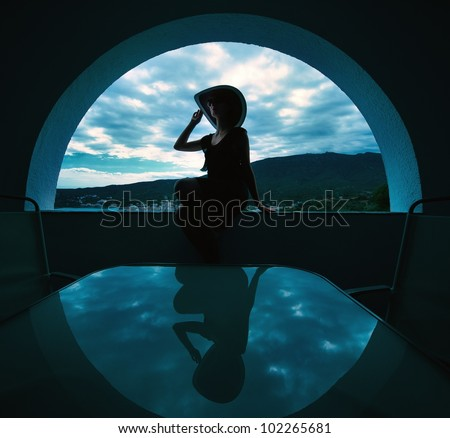 Woman's silhouette in window opening. - stock photo