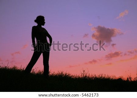 woman`s silhouette on sunset