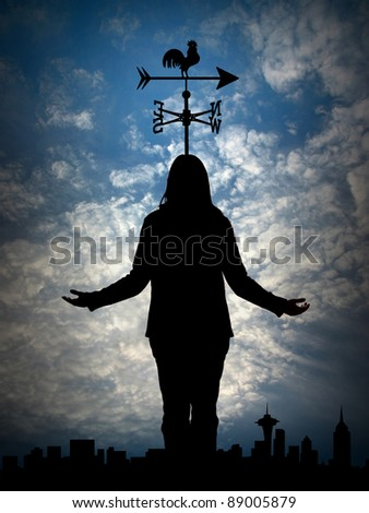 Woman`s silhouette with weather vane - stock photo
