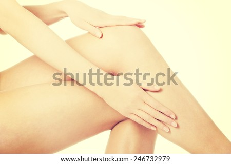 Woman's smooth knee pampering. Spa concept.