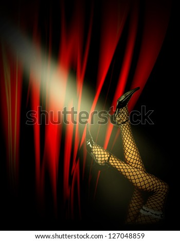 Woman's stockinged legs and high heels over cabaret red background in spotlights. - stock photo