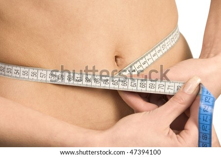 Woman's stomach with measure