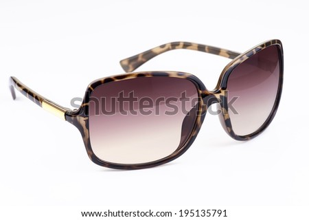 Woman's sunglasses with leopard pattern - stock photo