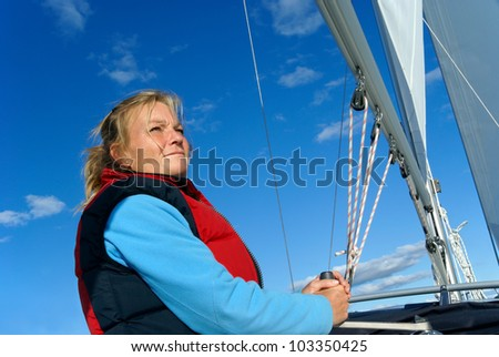 Woman sailing - stock photo