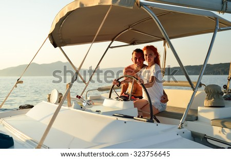 Woman sailing in the yacht on her honeymoon - stock photo