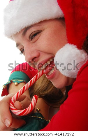 woman Santa eating candy cane isolated on white. - stock photo