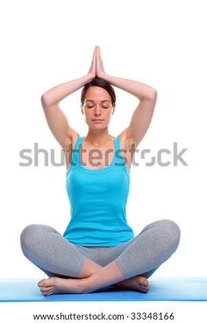 Woman sat in a yoga position meditating, isolated on a white background. - stock photo