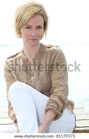Woman sat outside - stock photo