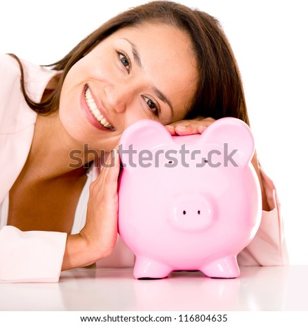 Woman saving money in a coin bank - isolated over white - stock photo