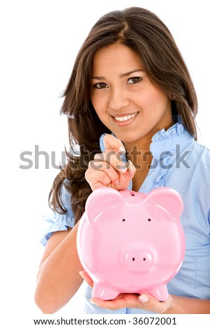 Woman saving money in a piggy bank isolated