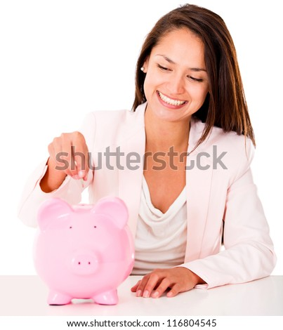 Woman saving money in a piggybank - isolated over a white backgorund