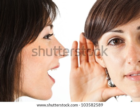 Woman saying a gossip to a friend - stock photo