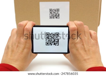 Woman scan qr code on box - stock photo