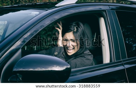 Woman scared about car accident - stock photo
