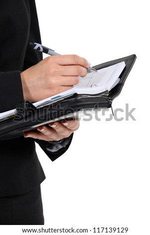 Woman scheduling an appointment into her agenda - stock photo