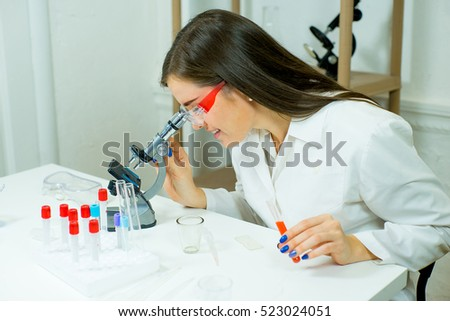 woman scientist doctor making science experiments in laboratory. education
