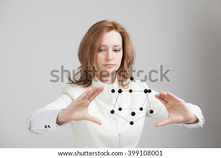 Woman scientist holding model of molecule or crystal lattice. - stock photo
