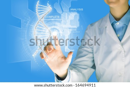 Woman scientist touching DNA molecule image at media screen - stock photo