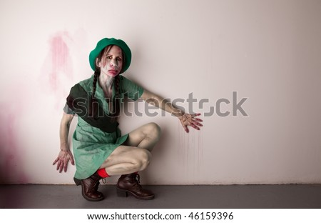 Woman scout zombie or ghoul covered in blood - stock photo