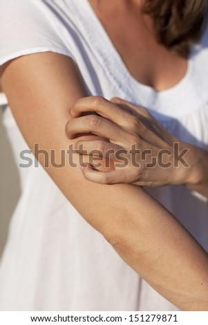 Woman scratching - stock photo