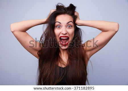 woman screaming and holding his head