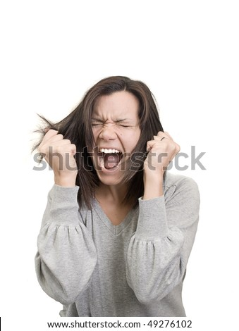 woman screams and pulls her hair in frustration - stock photo
