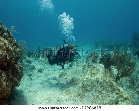 Woman Scuba Diver swimming over a Cayman Island Reef