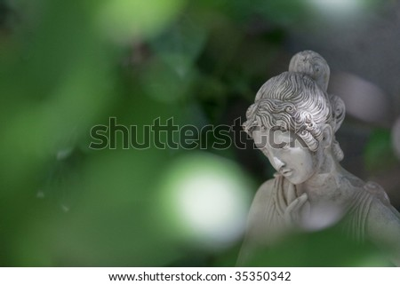 Woman sculpture face detail - stock photo