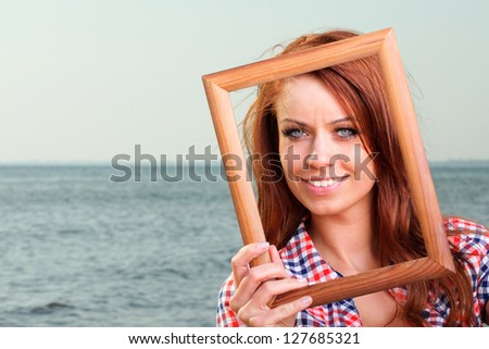 Woman sea sky vacation Holding Frame travel concept - stock photo