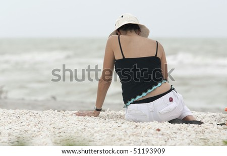 Woman Searching for Seashells - stock photo