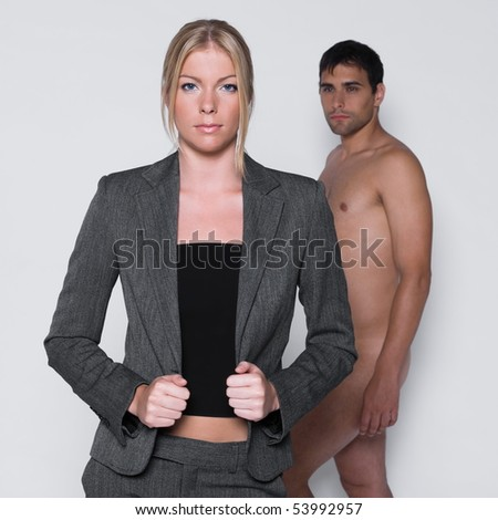 woman seductress with man naked in studio on isolated grey background - stock photo