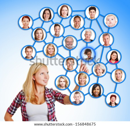 Woman selecting friends and family in social network with her finger - stock photo
