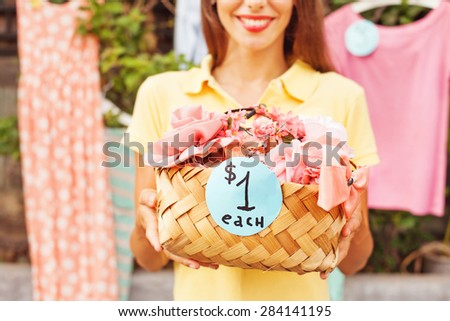 woman selling things on a garage sale  - stock photo