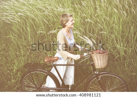 Woman Senior People Active Cycling Concept - stock photo