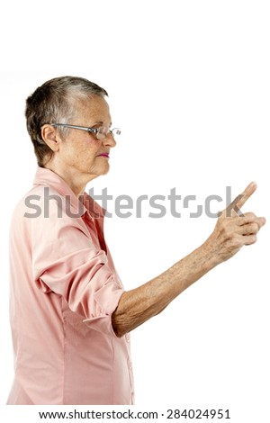 Woman Senior point at side, speaking . - stock photo