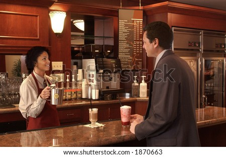 woman serving a businessman in a coffee shop - stock photo