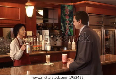 woman serving a businessman in a coffee shop