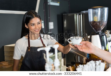 Woman serving coffee - stock photo