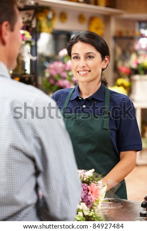 Woman serving customer in florist