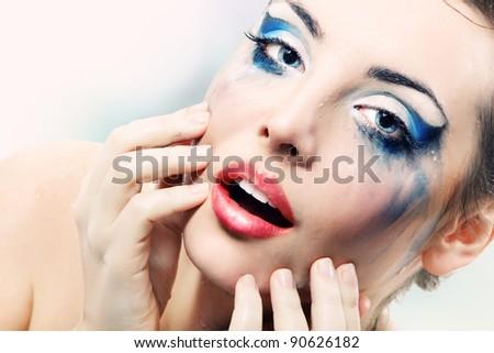 woman sexy beautiful wet washing make-up - stock photo