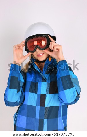 Woman sexy hot skier or snowboarder girl ski googles holding helmet. Winter sport activity. Beautiful seductive sportswoman on white studio shot