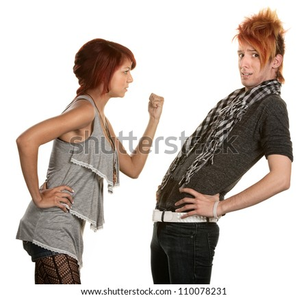 Woman shakes a clenched fist at boyfriend in orange hair
