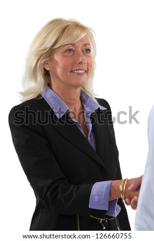 Woman shaking hands with a client - stock photo