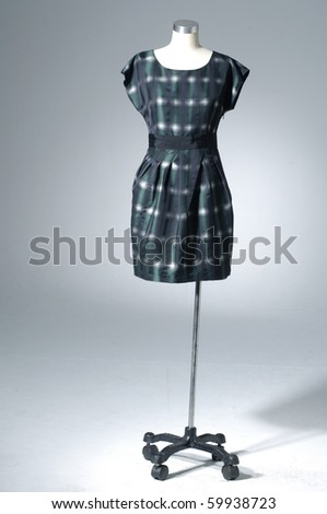 Woman shirt on mannequin on light background - stock photo