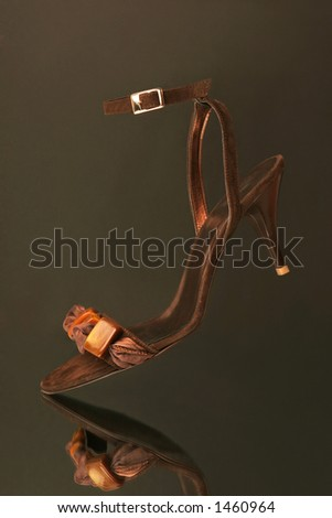 woman shoe gliding on a mirror