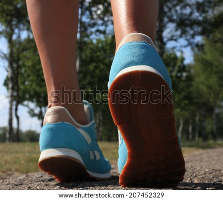 woman shoes running on the asphalt - stock photo