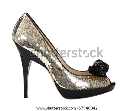 Woman shoes with golden sequin, isolated on the white background - stock photo