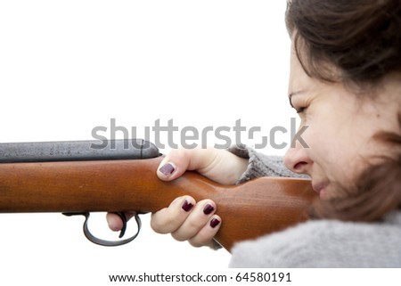 Woman shooting with air gun - isolated - stock photo
